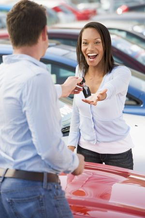 Woman shopping for a new car photo