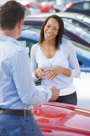 new car lots: Woman shopping for a new car