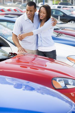 Young couple shopping for a new car Stock Photo - 3198232