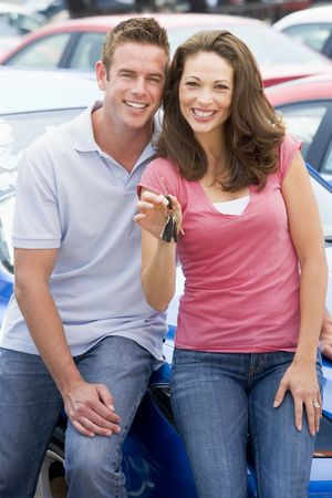 Young couple shopping for a new car photo