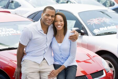 motorcars: Young couple shopping for a new car Stock Photo