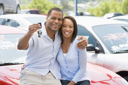 car dealers: Young couple shopping for a new car Stock Photo