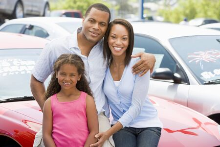 Mother and father with young daughter shopping for a new car Stock Photo - 3203066