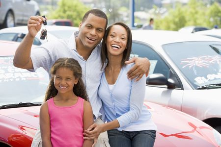 motorcars: Mother and father with young daughter shopping for a new car