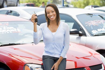 new car lot: Woman shopping for a new car