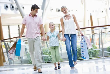 Mother and father with young daughter at a shopping mall Stock Photo - 3197966