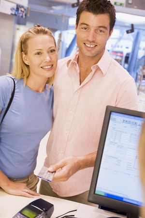 Man paying for purchases with credit card photo
