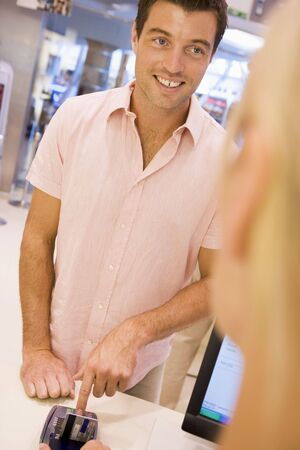 Man paying for purchases with credit card Stock Photo - 3198053