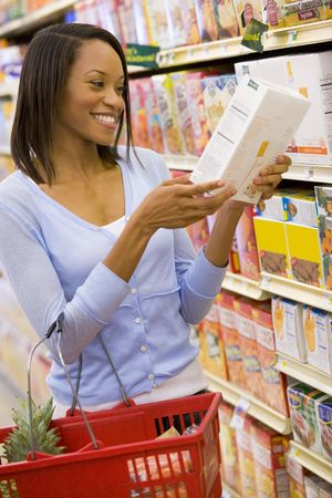 happy shopper: Woman shopping at a grocery store