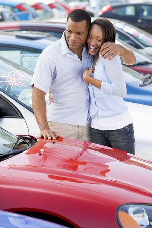 Young couple shopping for a new car Stock Photo - 3203434
