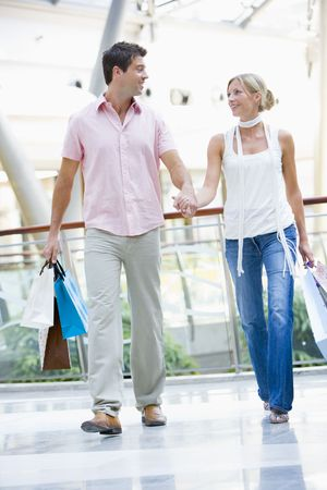 carrying girlfriend: Young couple at a shopping mall