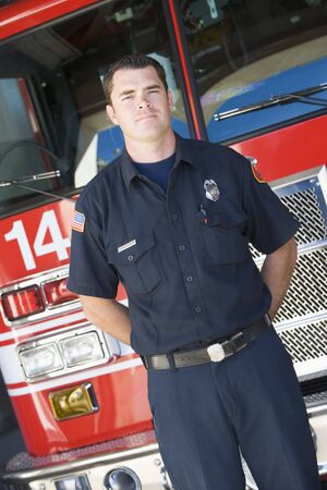 heroism: Fireman standing in front of fire engine Stock Photo