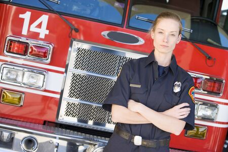offset angle: Firewoman standing in front of fire engine