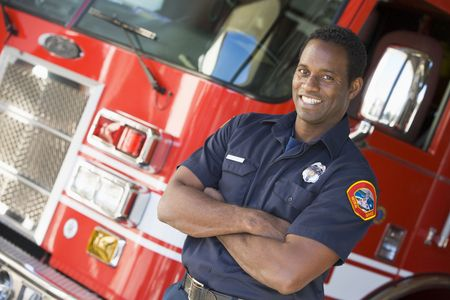 offset angles: Fireman standing in front of fire engine Stock Photo