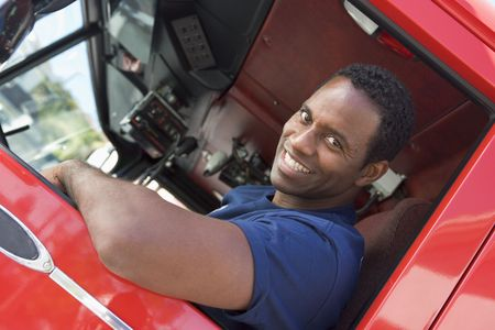 Fireman in drivers seat of fire engine photo