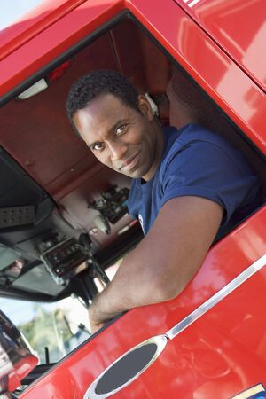 truck engine: Fireman in drivers seat of fire engine