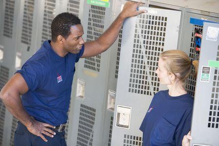 Two firefighters in locker room talking (depth of field) photo