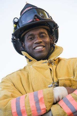 Fireman standing outdoors wearing helmet photo