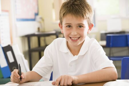 Estudiante en la clase tomando notas  Foto de archivo - 3225315