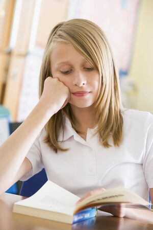 Student in class reading book Stock Photo - 3223736