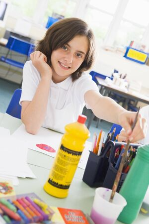 tweeny: Student in art class with paints