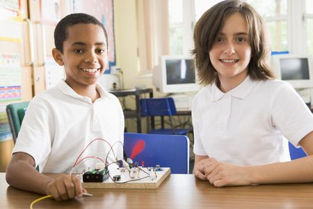 tween boy: Students in class with electronic project