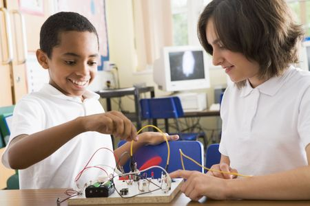 Students in class with electronic project photo