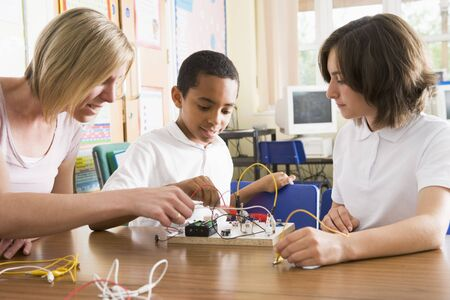 junior high: Students and teacher in class with electronic project Stock Photo