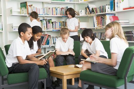 Seven students in library reading books photo