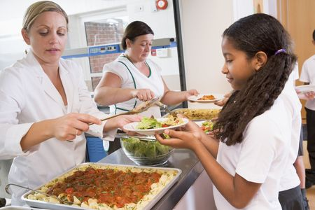 cafeterias: Students in cafeteria line being served lunch Stock Photo