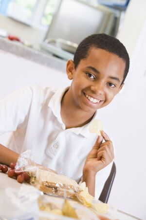 offset angle: Student in cafeteria eating lunch (selective focus) Stock Photo