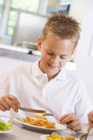 dinner wear: Student in cafeteria eating lunch (selective focus) Stock Photo
