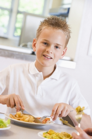 canteen: Student in cafeteria eating lunch (selective focus) Stock Photo