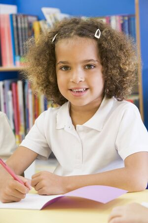 half dressed: Student in class writing in notebook (selective focus) Stock Photo