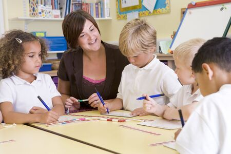 Students and teacher in math class with counting beads Stock Photo - 3225444