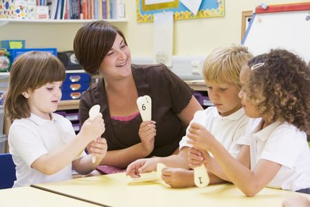 Students in class with teacher learning numbers Stock Photo - 3225353