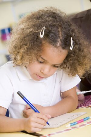 half dressed: Student in class learning numbers (selective focus) Stock Photo