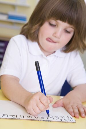 Student in class learning numbers (selective focus) photo