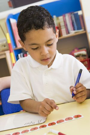 only boys: Student in class learning numbers (selective focus) Stock Photo
