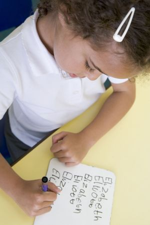 Student in class learning spelling (selective focus) photo