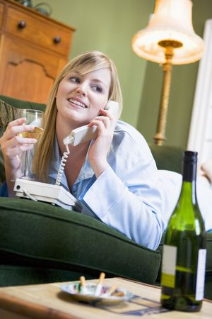 only one woman: Young woman at home talking on telephone Stock Photo