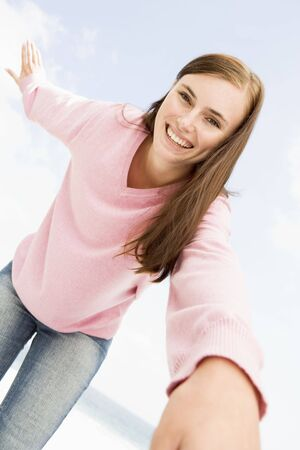 pullovers: Woman in a pink sweater posing