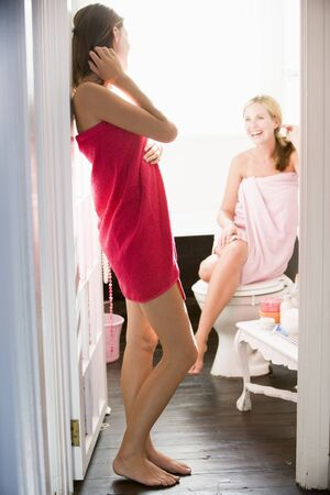 scantily clothed: Two women in a bathroom