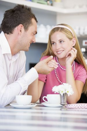dark blond: Young couple having tea in a cafeteria Stock Photo