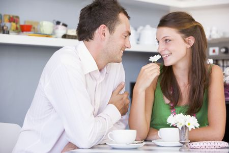 up date: Young couple having tea in a cafeteria Stock Photo