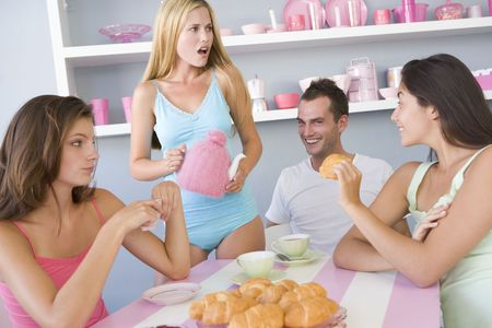 housemate: Three young women and a man sitting at a table having tea