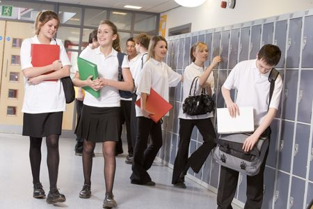 teenage girls: Secondary school students in a school hallway