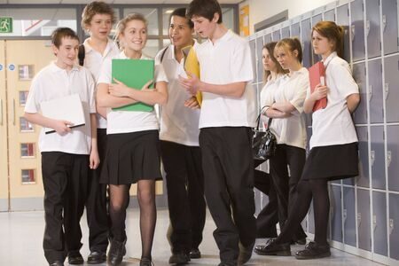 tween boy: Secondary school students in a school hallway