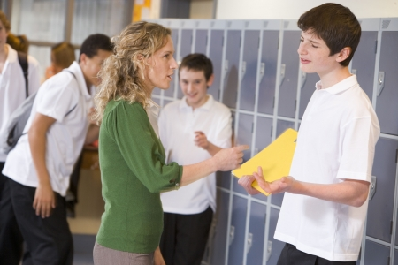 Female teacher reprimanding a male student Stock Photo - 3204285