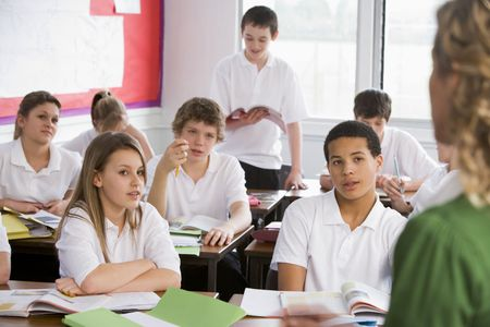 Secondary school student reading out loud in classroom photo
